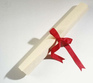 Piece of paper rolled and tied with ribbon